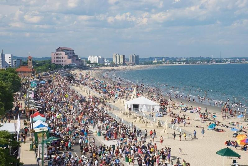 crowds and tents and umbrellas at revere beach boston
