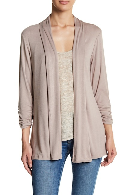 cream colored basic cardigan over white shirt and blue jeans