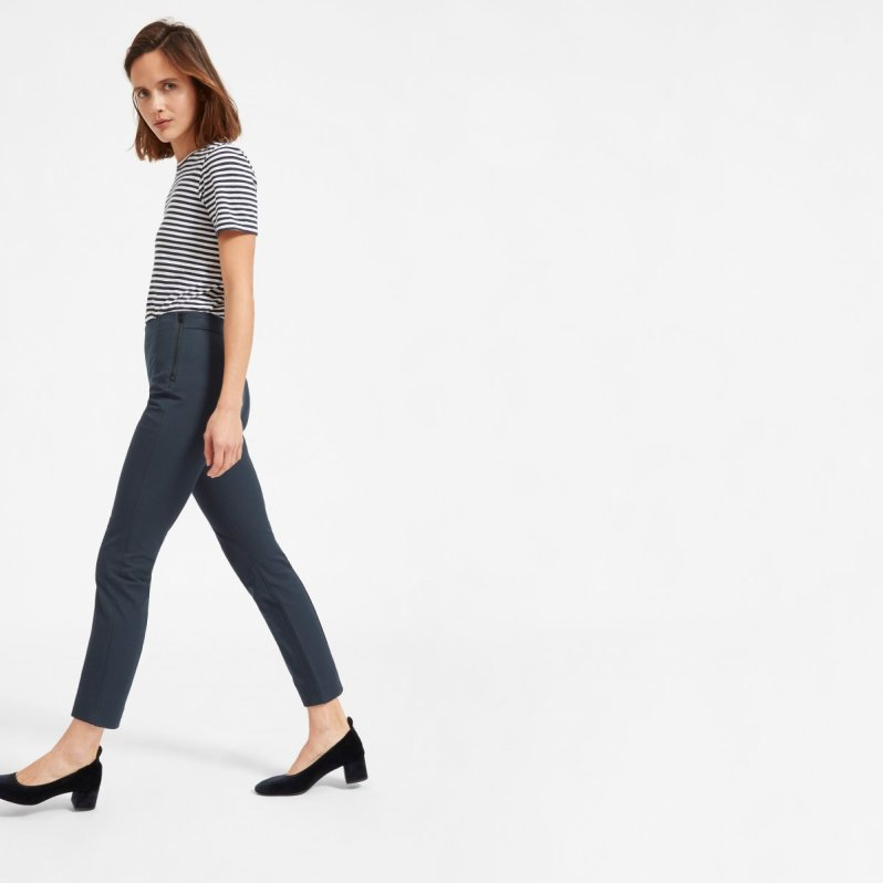 brunette girl in striped shirt and tailored work pants